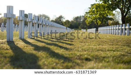 military cemetery with white crosses