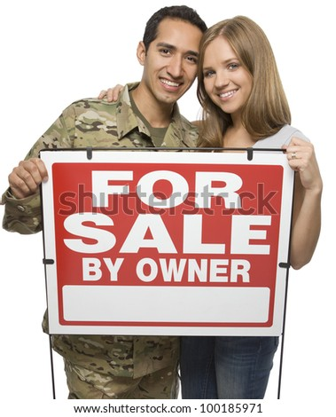 Military Couple Holding A For Sale By Owner Sign