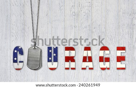 military dog tags for courage with flag font on weathered wood - stock photo