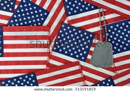 military dog tags on American flag collage background