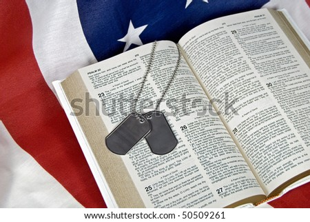 military dog tags on open holy bible - stock photo