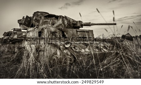 Military equipment since World War II. Burnt tank. - stock photo