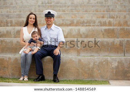 Military family in the park - stock photo