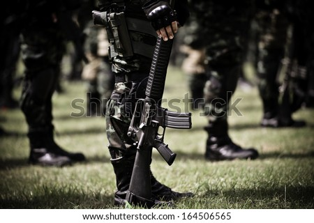 Military force uniform soldiers standing in a row - stock photo