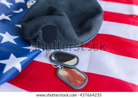 military forces, service, patriotism and nationalism concept - close up of american flag, soldiers badges and paratrooper hat