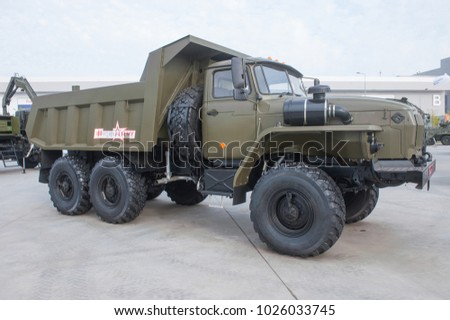 MILITARY GROUND ALABINO, MOSCOW OBLAST, RUSSIA - Aug 22, 2017: New Russian dump truck Ural-5557 International military-technical forum Army-2017, front view-right