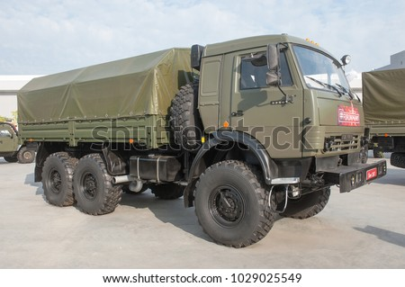 "MILITARY GROUND ALABINO, MOSCOW OBLAST, RUSSIA - Aug 22, 2017: Russian truck KAMAZ-5350 family ""Mustang"" in the International military-technical forum Army-2017, front view-right"
