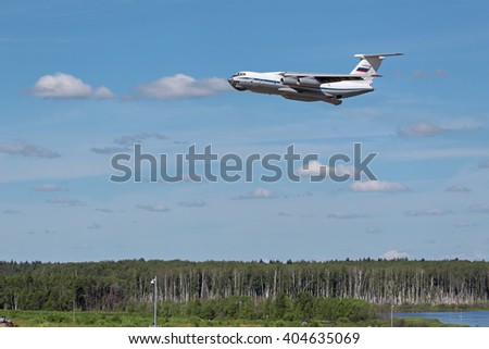 MILITARY GROUND ALABINO, MOSCOW OBLAST, RUSSIA - JUN 18, 2015: Cargo plane Ilyushin Il-76 flies over the Alabino training ground at the International military-technical forum ARMY-2015