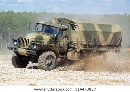MILITARY GROUND ALABINO, MOSCOW OBLAST, RUSSIA - JUN 18, 2015: The demonstration of the capabilities of a military truck Ural-43206 at the International military-technical forum ARMY-2015 - stock photo