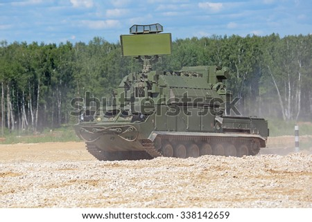 MILITARY GROUND ALABINO, RUSSIA - JUN 18, 2015: The independent combat module at the anti-aircraft missile complex Tor (SA-15 Gauntlet) at the International military-technical forum ARMY-2015 - stock photo