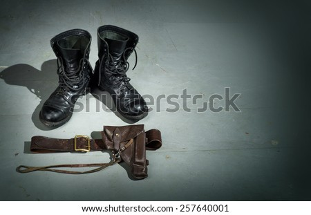 Military gun, belt, boots with high ankle boots