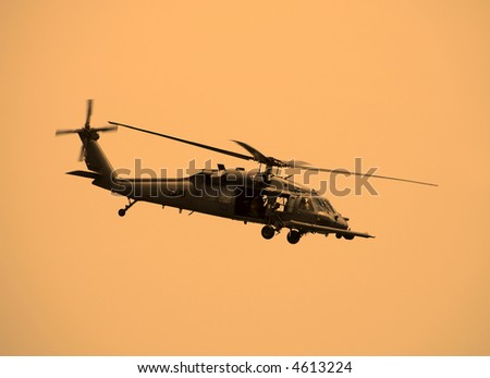 Military helicopter on patrol - stock photo
