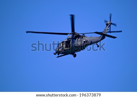 Military Helicopter Picture of a military helicopter flying over the Atlantic Ocean. - stock photo