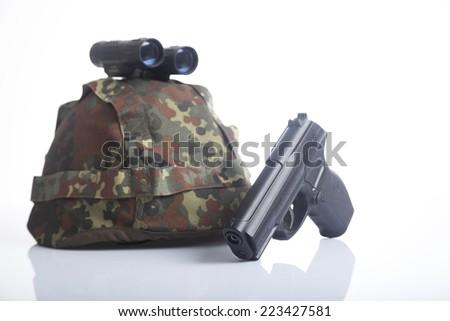 Military helmet and binoculars and semi-automatic gun isolated on white background - stock photo