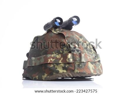 Military helmet and binoculars isolated - stock photo