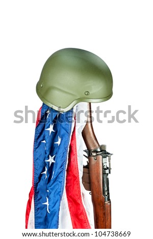 Military helmet on old WWII Enfield rifle with American flag - stock photo