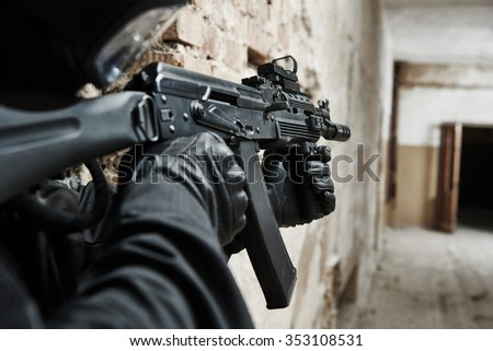 military industry. special forces or police soldier, private contractor armed with assault rifle ready to attack during clean-up operation, mission - stock photo