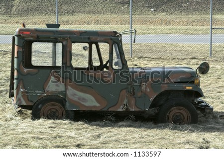 Military jeep from WWII era - stock photo