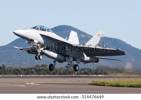 Military Jet blasting off the runway - stock photo