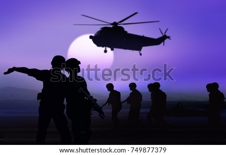 Military man and helicopter rescue mission on the ground