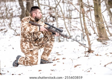 Military man in combat, camouflage uniform preparing for battle with enemy - stock photo