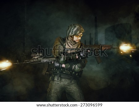 Military man soldier shooting  of two automatic rifles (machine gun)  in different directions - stock photo