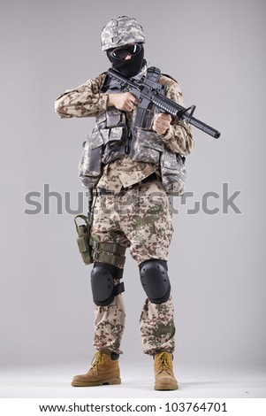 Military man, terrorist or soldier in camouflage with machine gun - stock photo