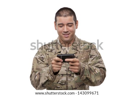 military man texting on phone - stock photo