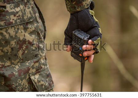 Military man with radio outdoor, He said on the radio - stock photo