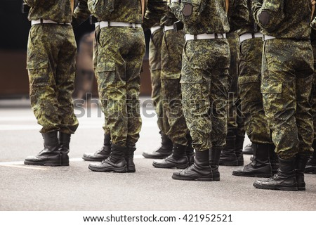 military men stand at attention