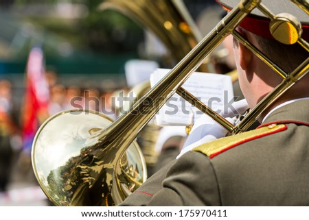 Military musicians are playing on the trombone - stock photo