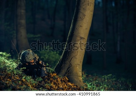 Military Night Time Operation. Army Soldier in the Dark Forest. - stock photo