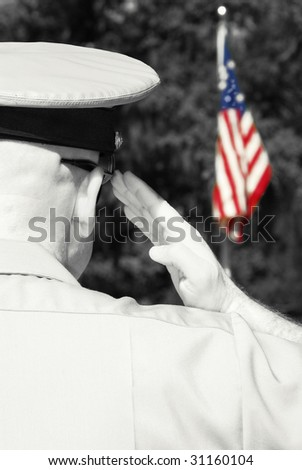Military officer rendering honors by saluting American flag - stock photo