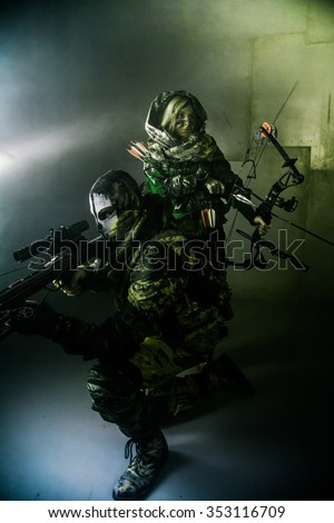 Military people are standing with crossbows. Fantasy. The post Apocalypse.  - stock photo