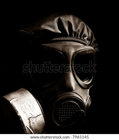 military person wearing a gasmask and protective clothing - stock photo