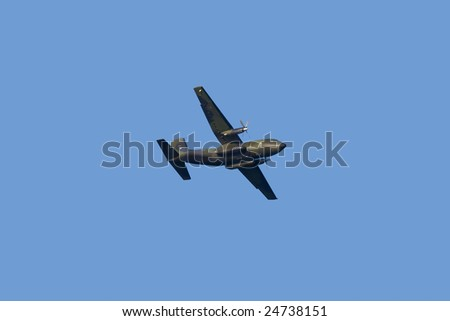 Military propeller aircraft flying in a clear skies - stock photo