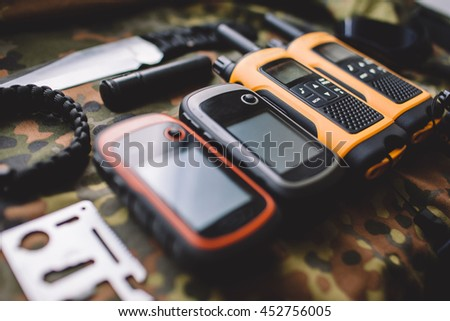 military radios in camouflage background - stock photo