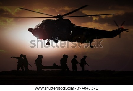 Military rescue helicopter during sunset - stock photo