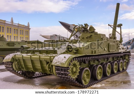 Military russian tank and aircrafts in the background - stock photo