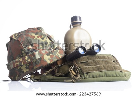 military set with helmet, binoculars and canteen - stock photo