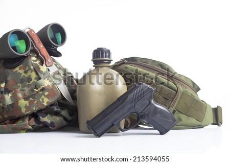 military set with helmet, binoculars,canteen and gun - stock photo