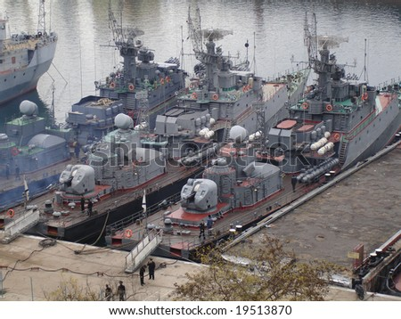 military ships in the harbour - stock photo