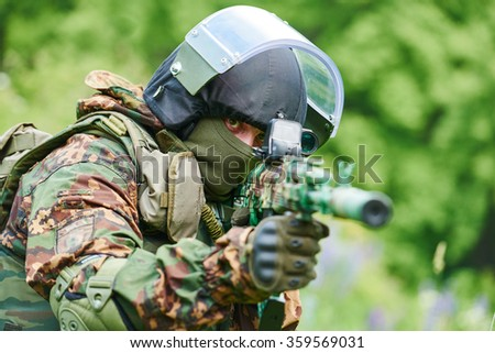Military soldier with assault rifle patrolling