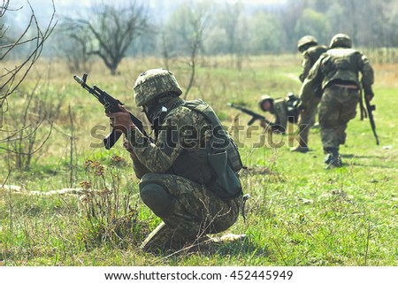 Military soldiers at tactical exercises with guns - stock photo