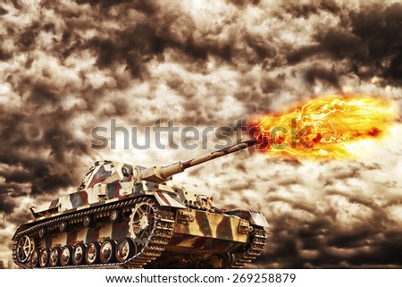 Military Tank firing with dark storm clouds in background, concept of war and conflict. - stock photo