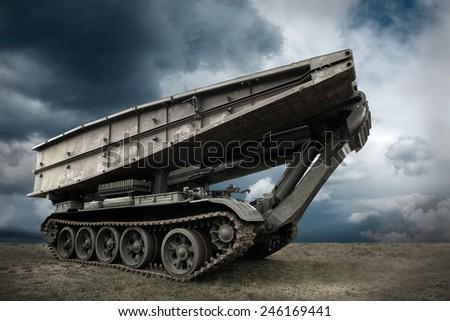 Military tank under sky - stock photo