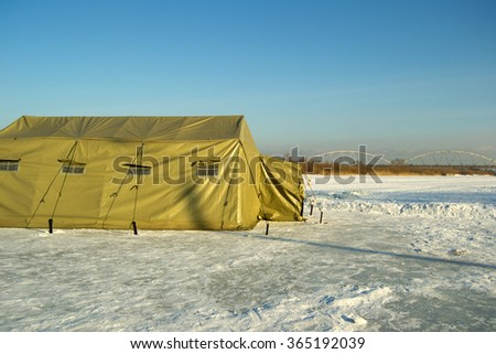 military tents on the ice of the river