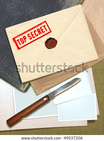 military top secret envelope with stamp and knife for papers - stock photo
