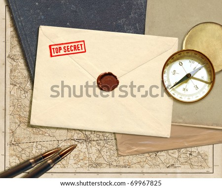 military top secret folder with stamp and map - stock photo