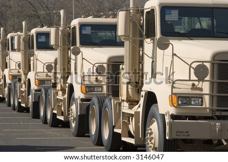 Military tractor lined up for delivery - stock photo
